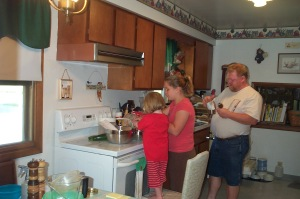 Nessa, Megan, and Shawn in the kitchen on my birthday